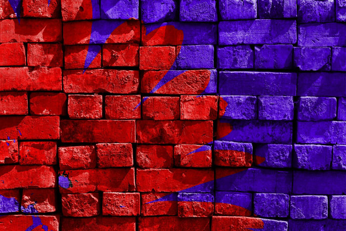 an example of analogous colors on a red and purple painted brick wall