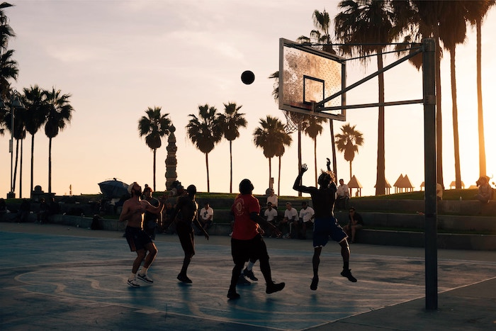 An outdoor basketball game in low light - cool basketball pictures