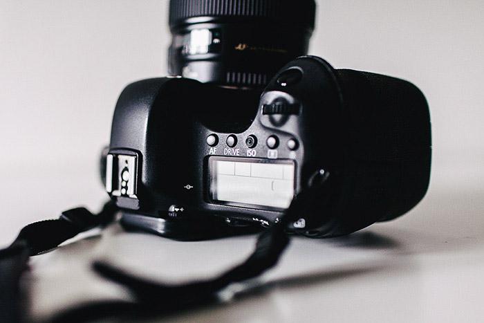 A DSLR camera on its side - burst mode photography