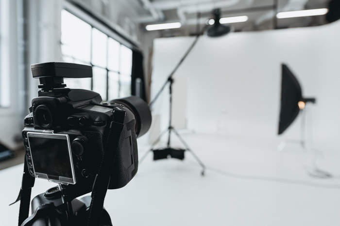 A DSLR on a trip set up in a photography studio
