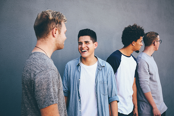 A candid portrait of a group of male friends hanging out - friendship images