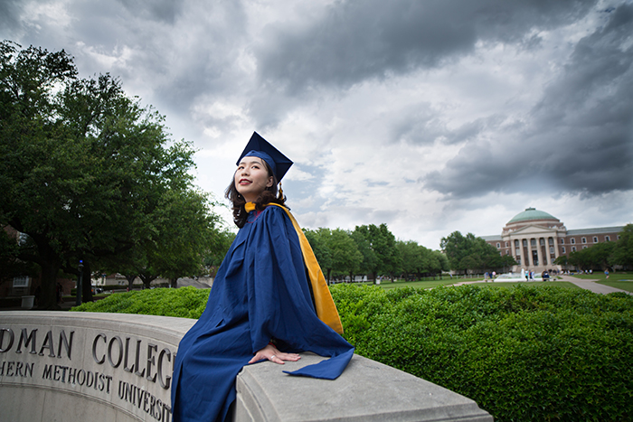 Beautiful graduation portrait of a female student posing outdoors