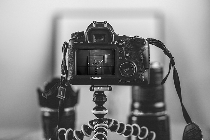 A close up of a DSLR camera set up on a tripod to shoot heart shaped bokeh