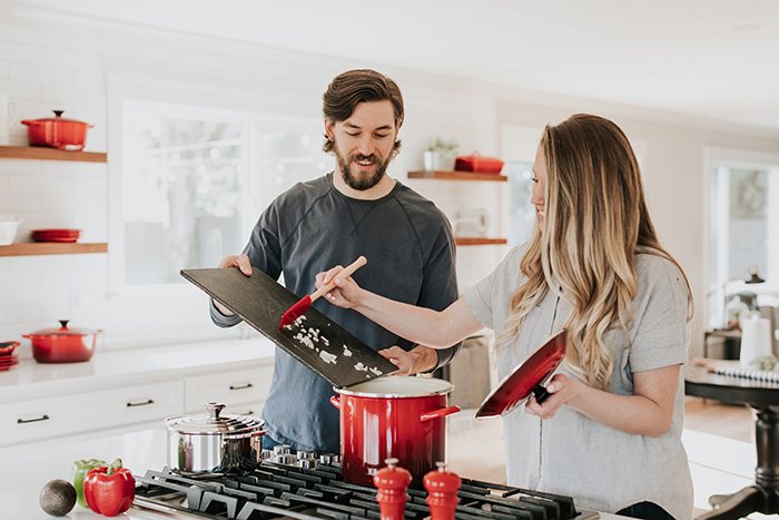 Casual lifestyle portrait of a couple cooking together