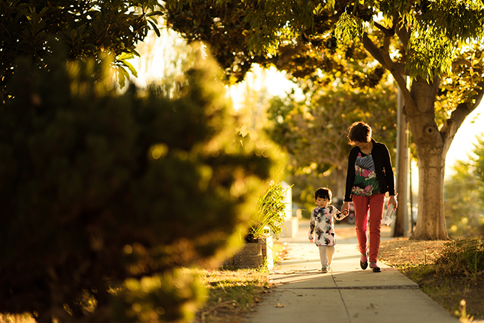 A mother and child walking down a path in evening light - lifestyle portrait tips