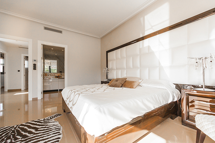 bright and airy photo of the interior of a bedroom shot in natural light