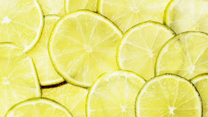 A close up photo of sliced limes using greeny yellow monochromatic color scheme
