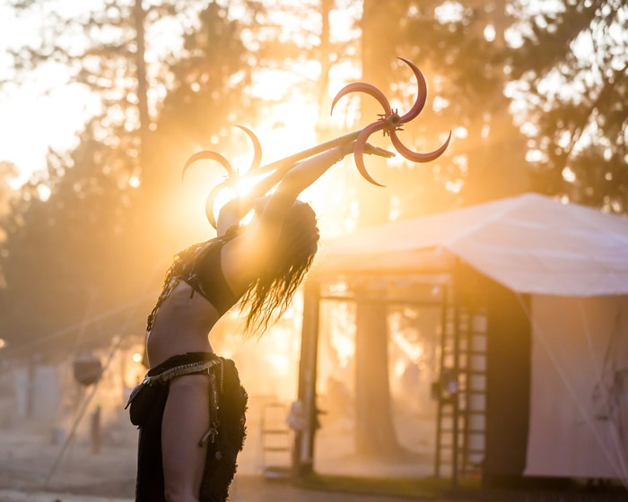 Atmospheric portrait of a dancer performing outdoors at a festival