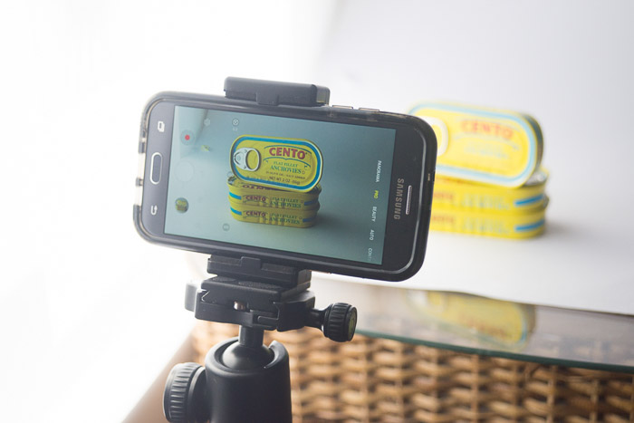 A phone set up on a tripod to shoot product shots - smartphone product photography