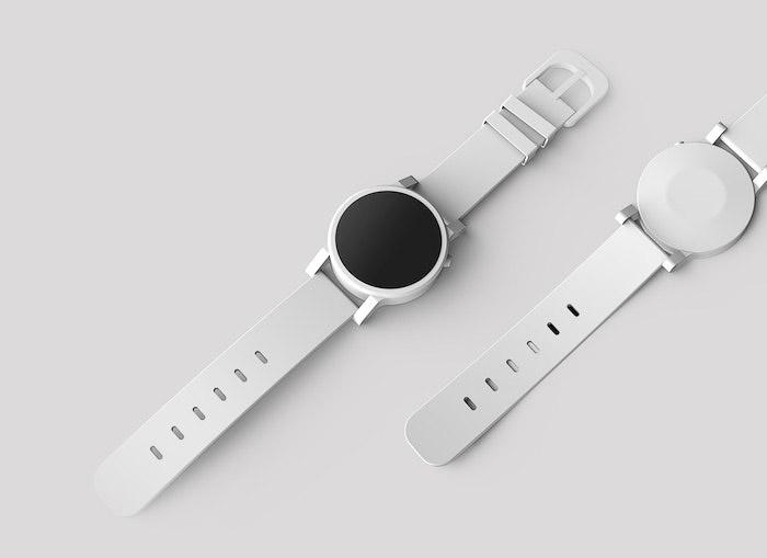 Desenho de produto plano de um relógio branco em uma mesa branca