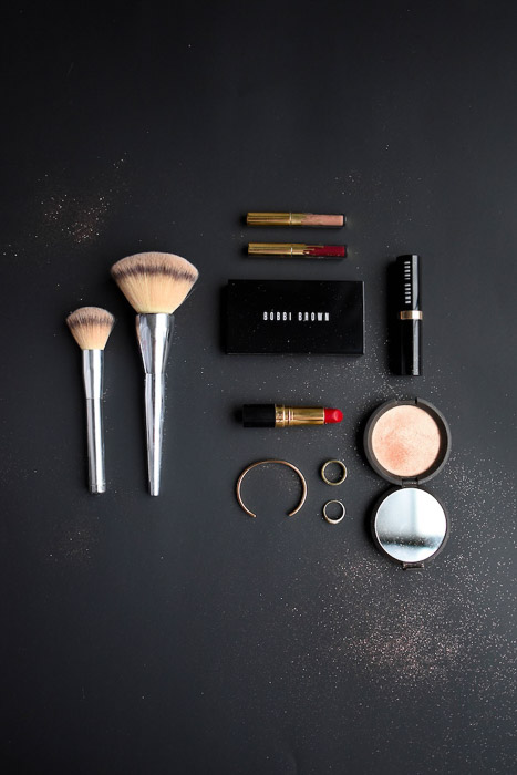 Flatlay product shot of cosmetics on a dark background - product photography business