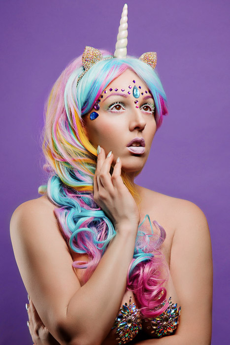 Creative self portrait boudoir photography of a female model in unicorn costume