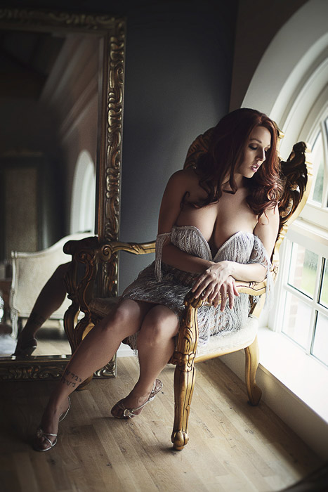 Sensual self portrait boudoir photography of a female model posing in a lavish interior
