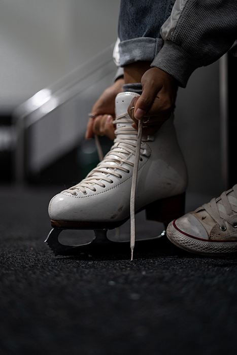 lose up of a skater tying the laces on their ice-skates