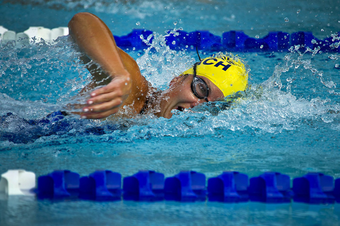 An action shot of a female swimmer - how to take swimming pictures
