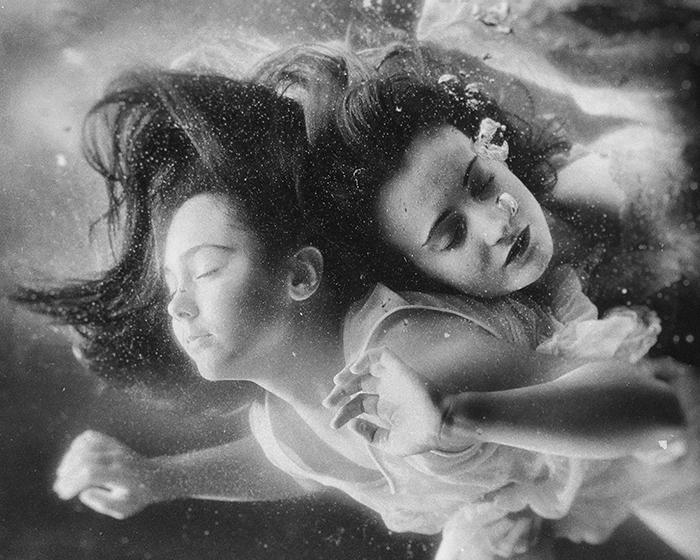 Atmospheric underwater photo of two female models