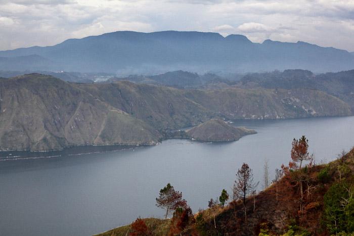 steep mountains surrounding the lake, the caldera of Toba volcano. -volcano and lava photography