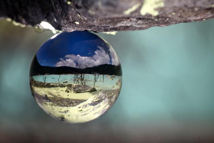 stunning crystal ball photography shot of an acid lake-volcano and lava photography