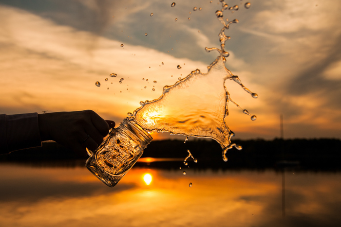 Creative water splash photography at a sunset outdoors
