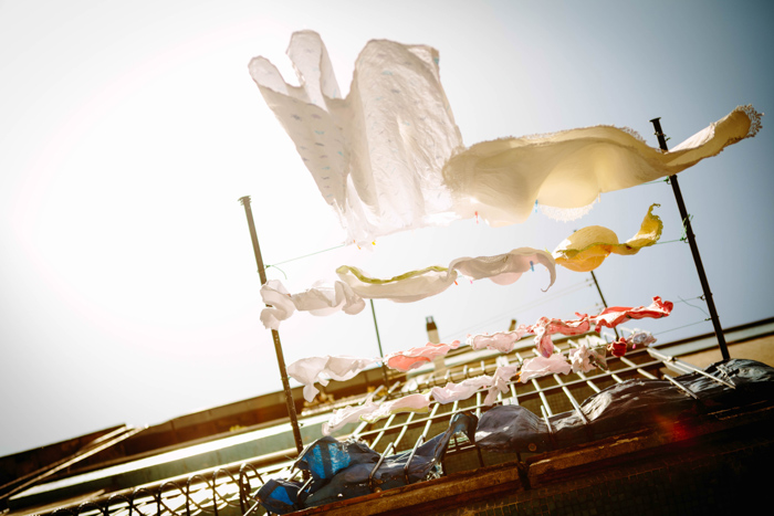 creative photo of laundry hanging outside a balcony shot from a low angle