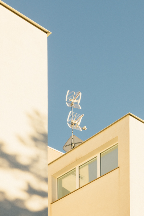 minimal shot of white walled buildings until blue sky - summer photography ideas