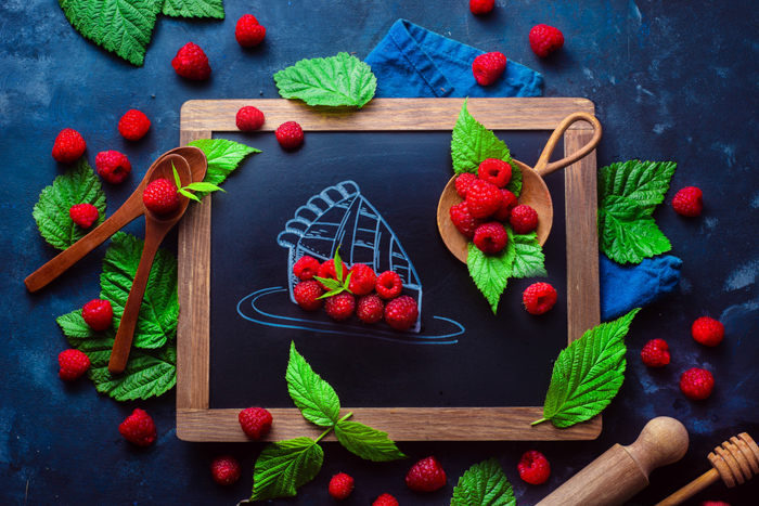 Creative flat lay featuring berries and a chalkboard