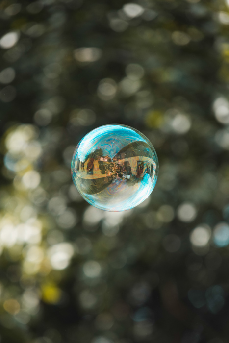 dreamy photo of a reflection in a soap bubble on a sunny day