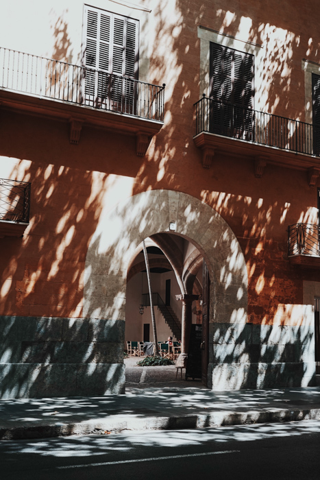 Dreamy photo of light and shadow on a building on a sunny day