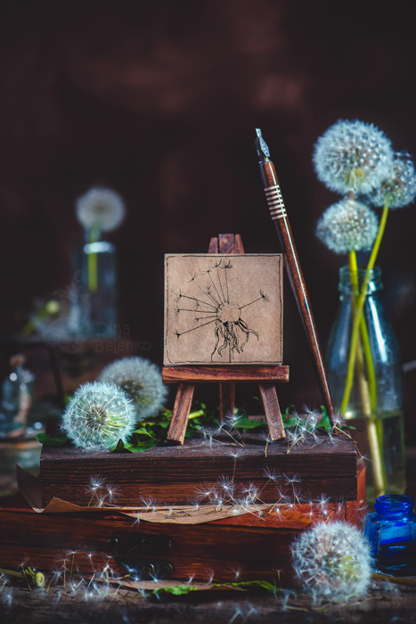 summertime themed still life with dandelions and stationary