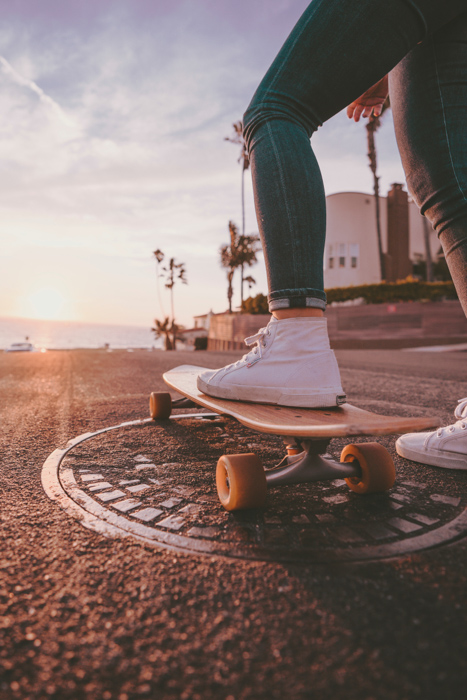 close up of a skateboarders feet - cool summer photography ideas