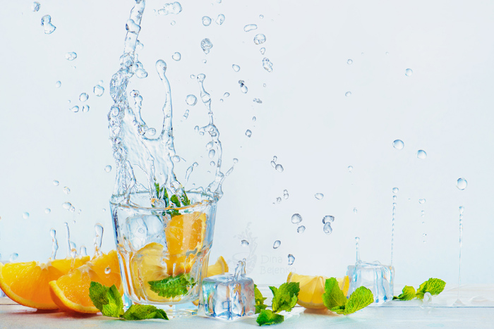 Cool summertime themed still life featuring citrus fruit and water splash