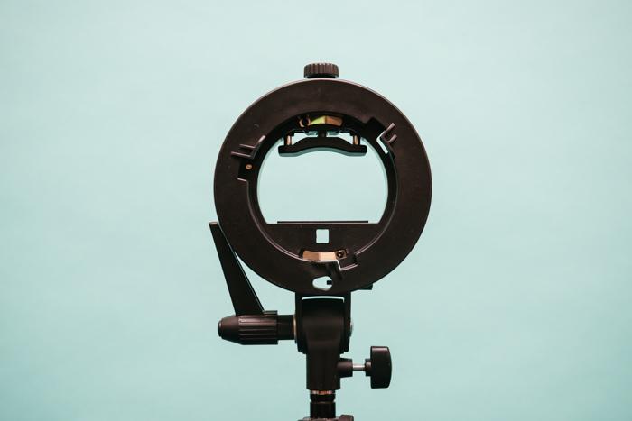 An S-type speedlight mount. three point lighting