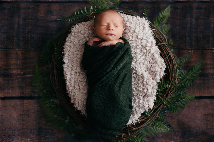 A sweet overhead portrait of a baby girl in a rustic basket - diy newborn photography