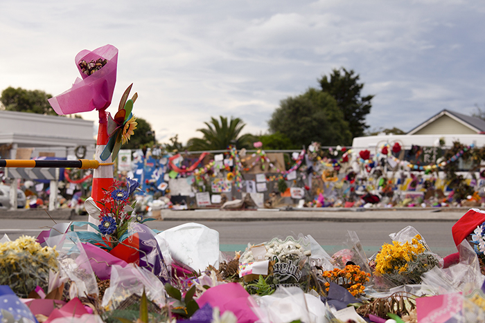 Fine art street photo of a floral tribute outside a Christchurch Mosque.