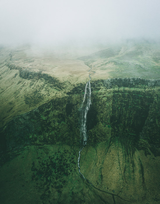a birds eye view of a beautiful mountainous landscape with a waterfall - stunning landscape photos