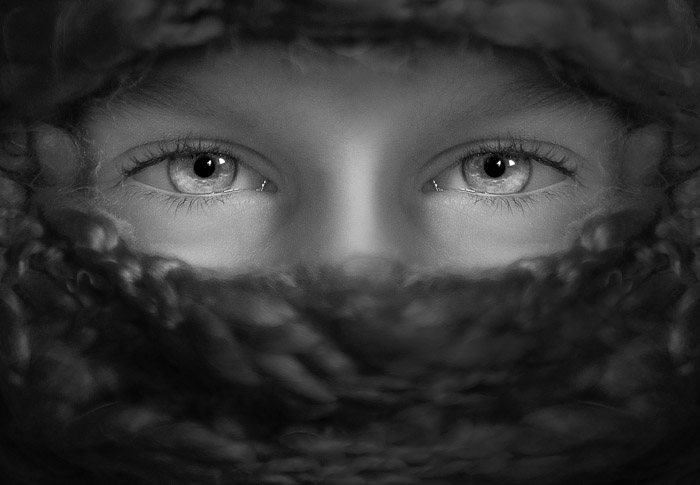 A monotone portrait of a female models eyes featuring stunning catchlights