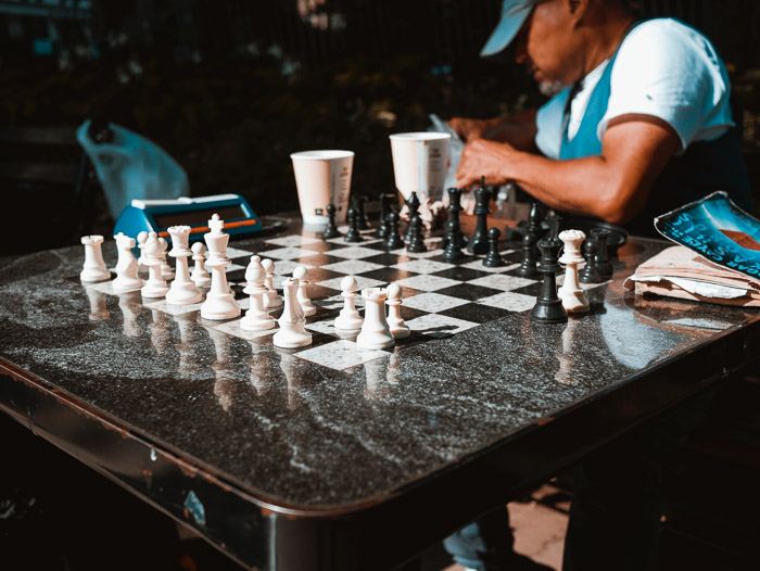 Candid chess photography shot of an outdoor board and chess players