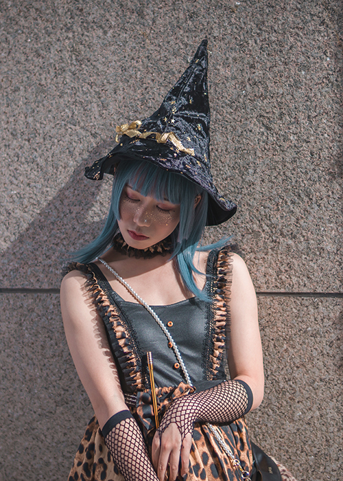 Cosplay photography of a female model dressed as a witch fairy