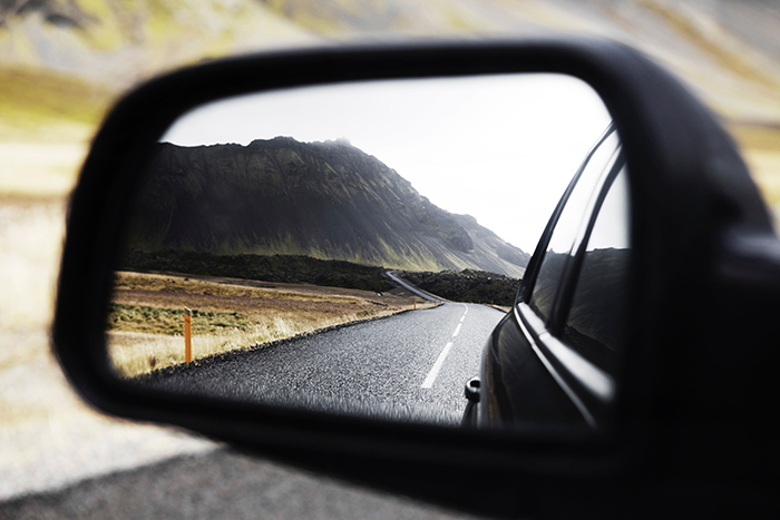 A stunning view of a mountainous landscape shot through a car mirror - Iceland photography tips