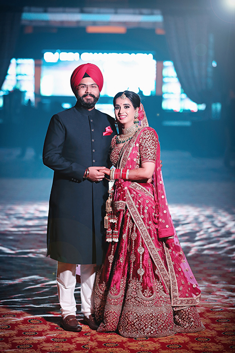 Beautiful wedding portrait of an Indian couple posing in traditional costume - Indian wedding photography