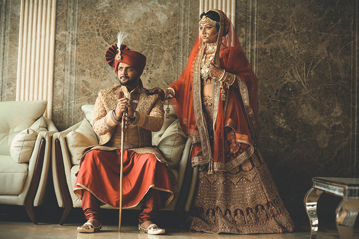 Beautiful wedding portrait of an Indian couple posing in traditional costume