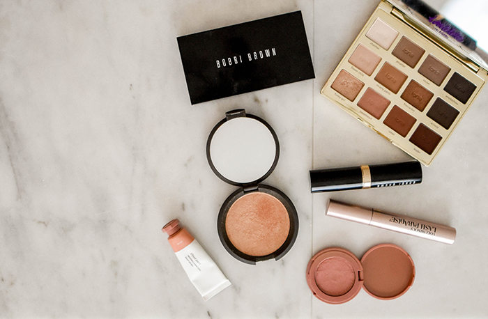 Flat lay of cosmetics for a makeup product shoot
