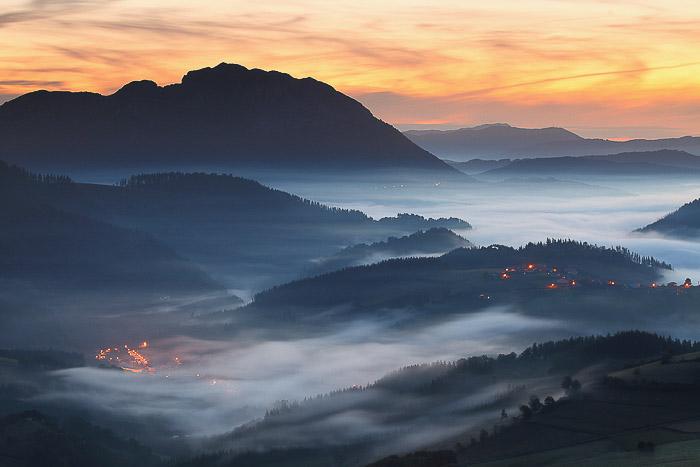 A foggy landscape at sunset