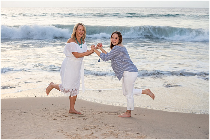 Sweet portrait of a mother and daughter on the beach - mother daughter photoshoot