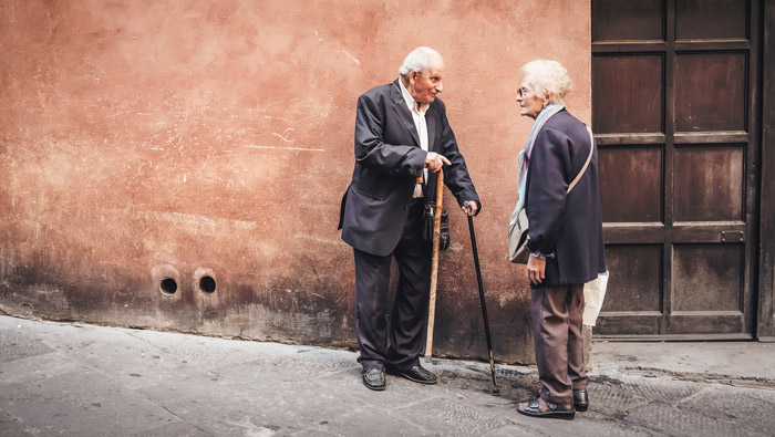 Street portrait of an elderly couple chatting - photography themes