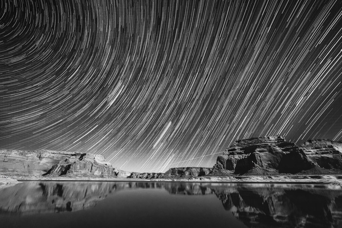 startrails over a rocky mountainous landscape shot in black and white - stunning landscape photos