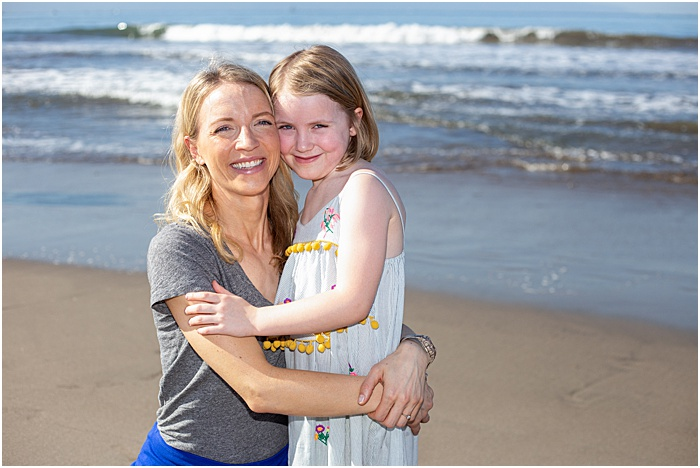 A mother daughter photoshoot outdoors on the beach