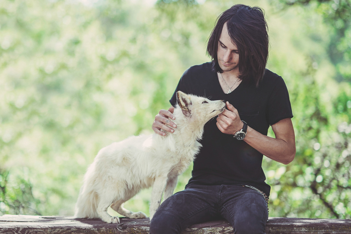 Sweet outdoor portrait of a man with a white dog - aperture for pet photography