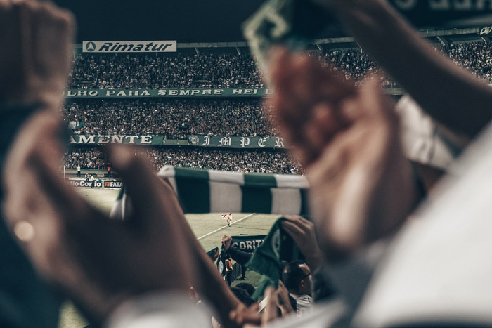 A soccer photography shot of a stadium full of fans