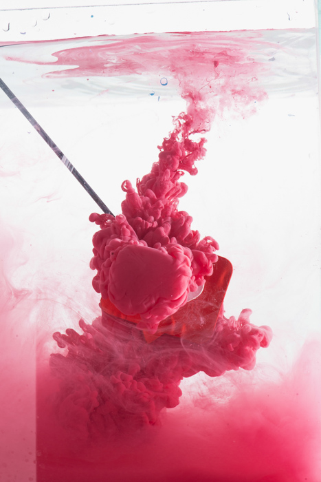setup to shoot colorful paint in water photography